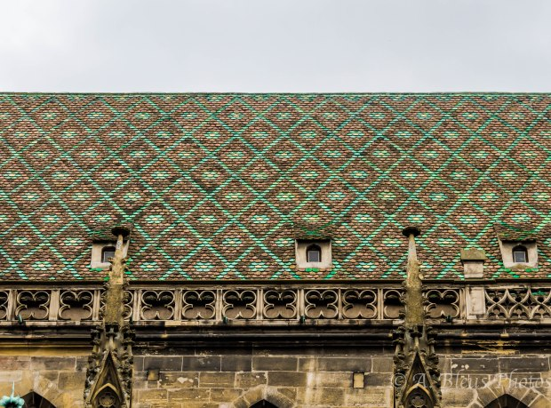 This church's roof with its diamond shape, green and rust tiles is remarkable and an eye-catcher.