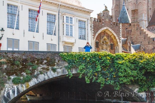 Man on Bridge in Brugge, Belgium