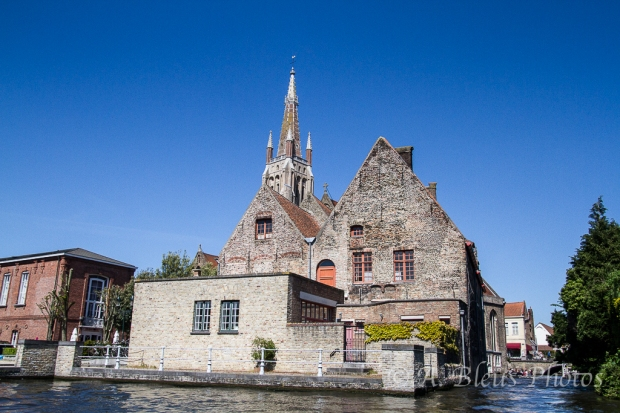 View of Church from Canal in Brugge, Belgium